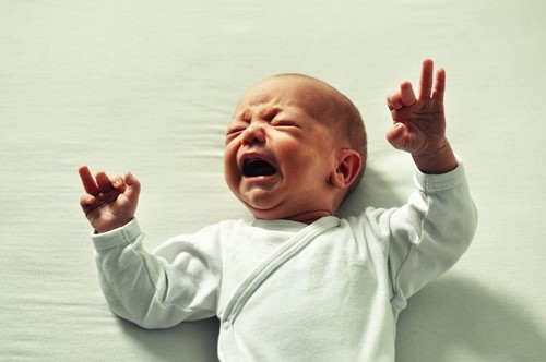 Why is my baby crying after feeding?  image