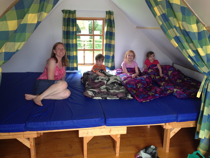 The sleeping area is one big bed, with plenty of space for 2 adults and 3 children.