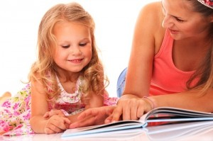 The simple act of reading with your child will help them develop a love of learning