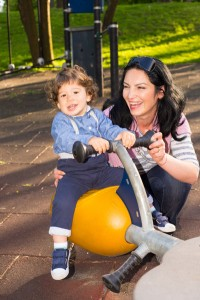 Encourage your toddler to step outside their comfort zone. If, for example, they are hesitant about getting onto a see-saw at the park, stand behind them and hold them so that they know they are safe.