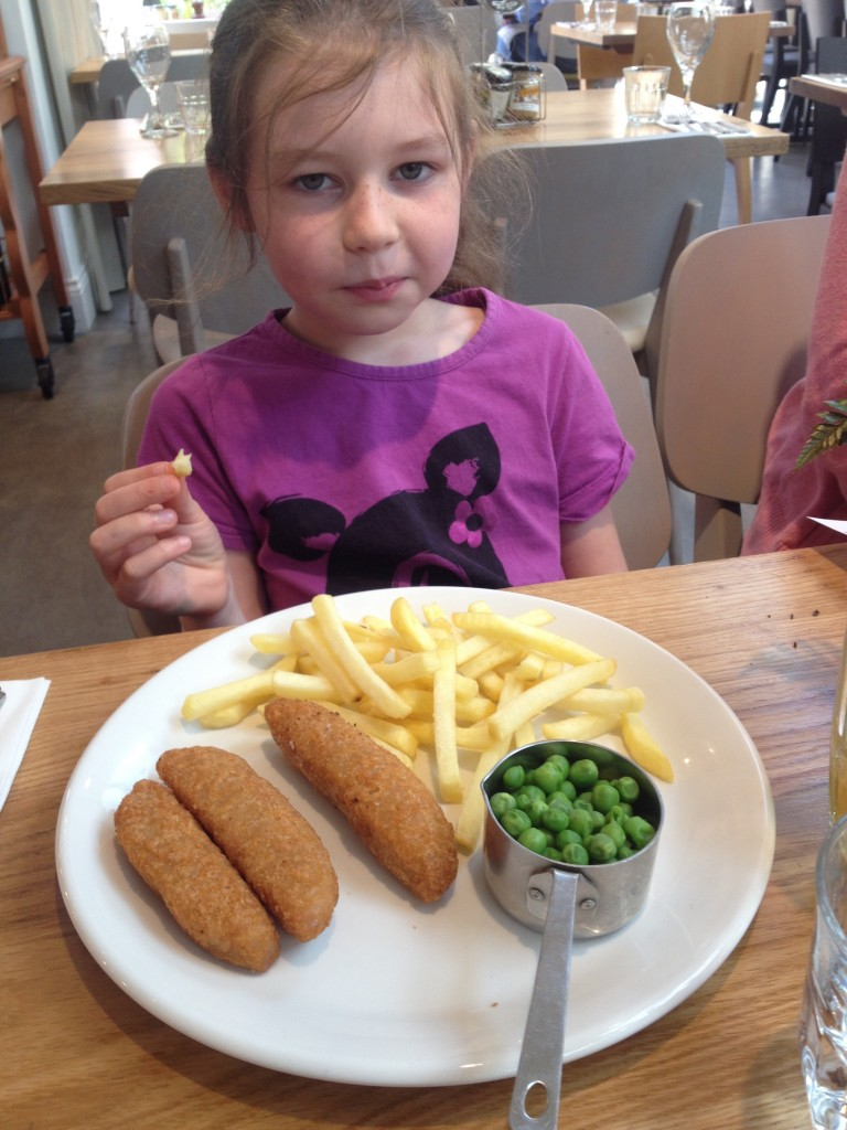 Children's portion of Cod Goujons, fries and peas. Perfectly cooked.
