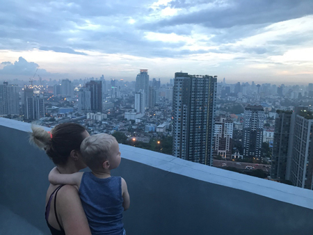 Jasper and I admiring the Bankok skyline from the rooftop of my brother's apartment on On Nut